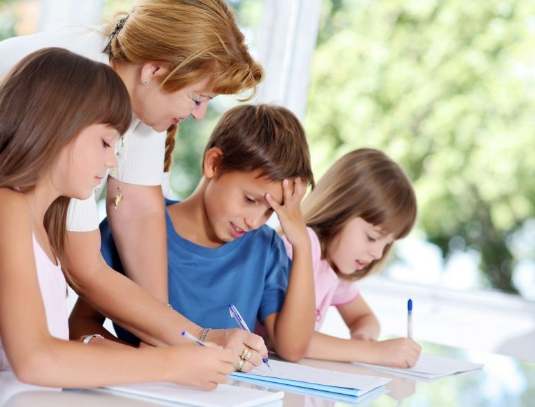 Counselor helping students write