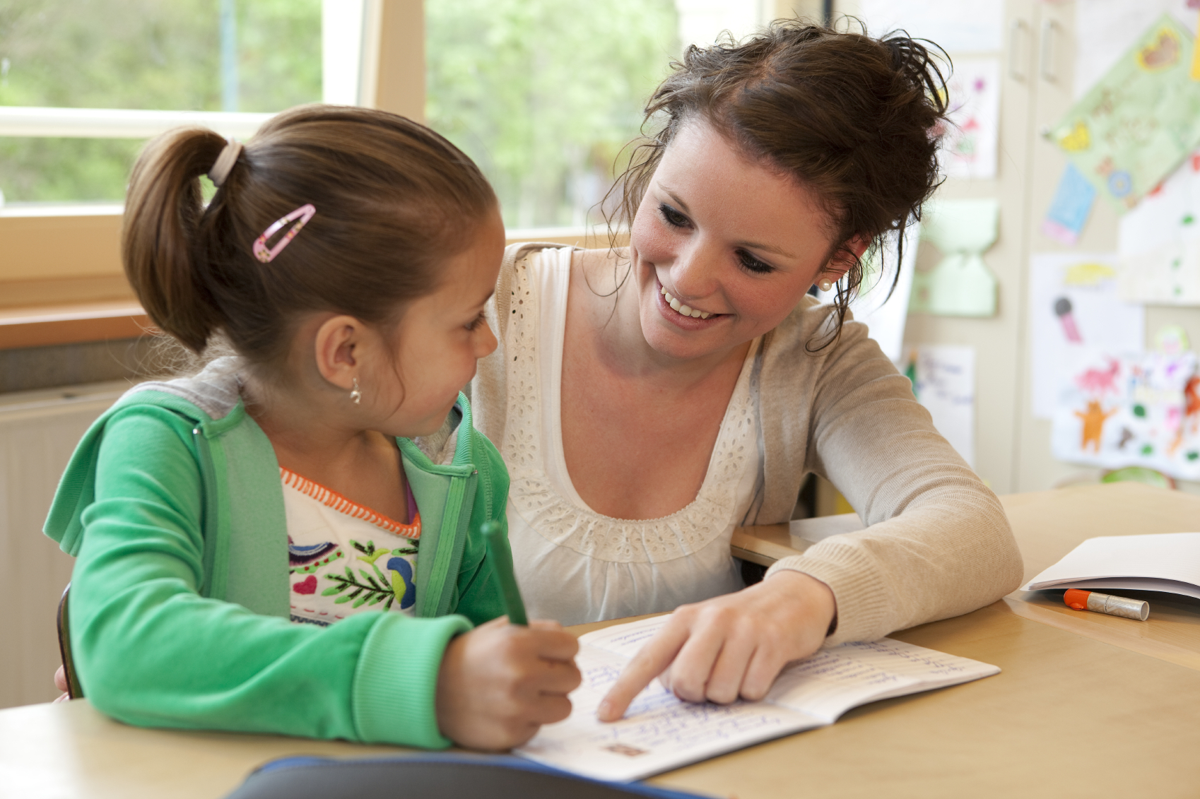Counselor helping a student with homework